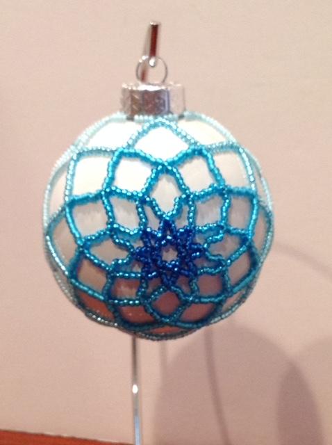 Blue Poinsettia ornament (Item #4102) $20.00