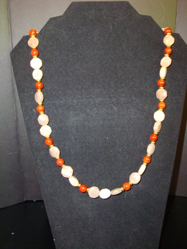 Fire (Agate) and Sun(stone) (Item #1107)  $20.00